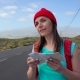 Traveler Woman Hitchhiking on a Sunny Road and Walking. Backpacker Woman Looking for a Ride To Start - VideoHive Item for Sale