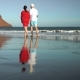 Couple in Love Carefree Walking To the Water on the Beach. Picturesque Ocean Coast of Tenerife - VideoHive Item for Sale