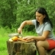 A Young Woman Is Cutting an Apple Into Slices for a Fruit Salad for Breakfast in Nature. - VideoHive Item for Sale