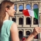 Young Woman Standing Near Colosseum in Rome, Italy. Teenage Girl Waving Italian Flag - VideoHive Item for Sale