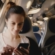 Shot of Beautiful Happy European Girl Using Smartphone Social Network App Traveling on Train Window - VideoHive Item for Sale