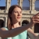 Woman Do Selfie on Mobile Phone Near Colosseum in Rome, Italy - VideoHive Item for Sale