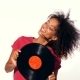 Young Pretty African American Woman in Red Top Enjoying and Dancing with Vinyl Record - VideoHive Item for Sale