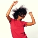 Young Attractive African American Woman in Red Top Enjoying Life and Dancing at White Background - VideoHive Item for Sale