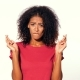 Attractive African Woman in Red T-shirt Praying and Crosses Her Fingers Over White Background - VideoHive Item for Sale