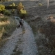 Aerial View of Cyclist Walking Down Mountain Road - VideoHive Item for Sale