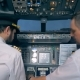 Aviation Specialist Is Instructing Another Pilot Before the Flight in the Cockpit - VideoHive Item for Sale