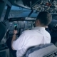 Airplane Pilot Instructor and a Man Are Managing Flight Simulation Process - VideoHive Item for Sale