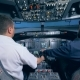 Two Men Are Sitting in a Cockpit of a Flight Simulator - VideoHive Item for Sale
