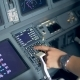 Pilot Is Entering Data Into Airplane Control System - VideoHive Item for Sale