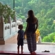 A Young Woman and Her Little Son Visit Kek Lok Si Buddhist Temple on Penang Island, Malaysia - VideoHive Item for Sale