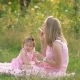 Mom and Daughter Are Sitting on the Lawn - VideoHive Item for Sale
