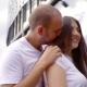 Happy Loving Pair Are Standing Outdoors in Summer Day, Man Is Hugging Woman and Her Long Hair Is - VideoHive Item for Sale