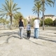 Mother, Father and Son Walking between Palm Trees - VideoHive Item for Sale