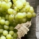 A Bunch of Grapes Falls Into the Basket on the Table Top View - VideoHive Item for Sale