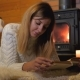 Woman Lying On A Soft Carpet By The Burning Fireplace And Reading A Book - VideoHive Item for Sale