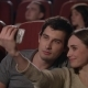 Girl Making Selfie on Smartphone with Boyfriend in Movie Theatre - VideoHive Item for Sale