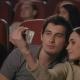 Kiss Selfie in Cinema. Happy Couple Making Selfie in Cinema - VideoHive Item for Sale