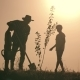 A Happy Family. Father and Two Sons Plant and Water the Tree in the Park at Sunset - VideoHive Item for Sale