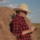 A Woman Is a Farmer with a Tablet at a Haystack. Farming. Preparation of Fodder for Winter - VideoHive Item for Sale