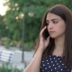 Sad Stylish Girl Is Chatting on Smartphone with Her Folks in Summer - VideoHive Item for Sale