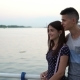 Young Man Embraces His Girlfriend and Chats Romantically on a Quay at Sunset - VideoHive Item for Sale