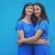 Girls Twins Posing , Smiling Over Blue Background - VideoHive Item for Sale