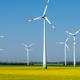 Modern wind wheels in a field of blooming rapeseed oil - PhotoDune Item for Sale