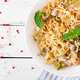 Creamy pasta with chicken and eggplant  served in deep plate. Italian food. Top view. Flat lay. - PhotoDune Item for Sale