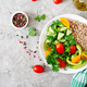 Healthy vegetarian salad of fresh vegetables - tomatoes, cucumber, sweet peppers and porridge - PhotoDune Item for Sale