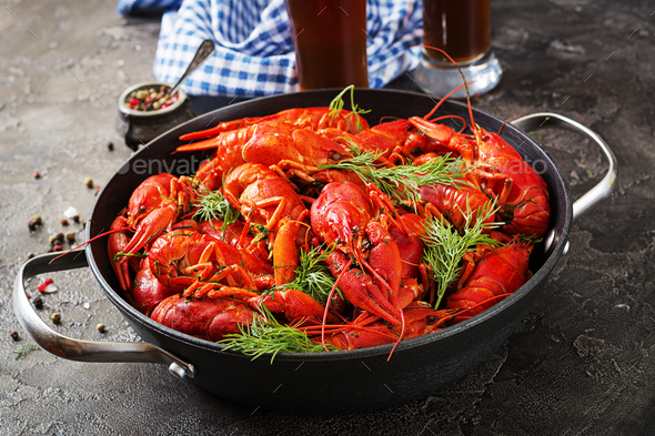 Crayfish. Red boiled crawfishes on table in rustic style, closeup. Lobster closeup. Border design - Stock Photo - Images