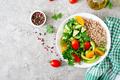 Healthy vegetarian salad of fresh vegetables - tomatoes, cucumber, sweet peppers and porridge - PhotoDune Item for Sale