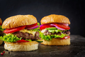 Hamburger with beef meat burger and fresh vegetables on dark background. Tasty food. - PhotoDune Item for Sale