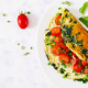 Omelette with tomatoes, spinach and green onion on white plate. - PhotoDune Item for Sale