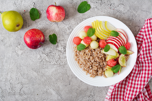 Buckwheat or porridge with fresh melon, watermelon, apple and pear.  - Stock Photo - Images