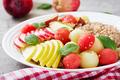 Healthy breakfast. Buckwheat or porridge with fresh melon, watermelon, apple and pear. Tasty food. - PhotoDune Item for Sale