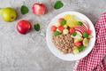 Buckwheat or porridge with fresh melon, watermelon, apple and pear.  - PhotoDune Item for Sale