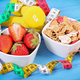 Fresh strawberries, wheat and rye flakes, dumbbells and centimeter - PhotoDune Item for Sale