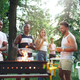 Group of friends making barbecue in the backyard. concept about good and positive mood with friends - PhotoDune Item for Sale