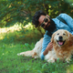 Man with beard and his small yellow dog playing and enjoying sun - PhotoDune Item for Sale