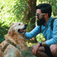 Handsome young man with golden retriver outdoors - PhotoDune Item for Sale