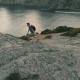 Man Climbs the Rocks and Raises His Hands - VideoHive Item for Sale