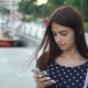 Stylish Girl Is Texting and Browsing the Net on Her Phone on a Riverbank in Summer - VideoHive Item for Sale