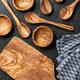 Wooden utensil set on black stone surface - PhotoDune Item for Sale