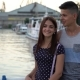 Young Man Embraces His Girl and Talks Romantically on a River Quay at Sunset - VideoHive Item for Sale
