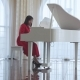 Beautiful Woman Plays a White Piano - VideoHive Item for Sale