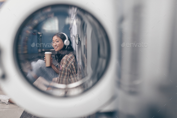 Smiling girl in laundry - Stock Photo - Images