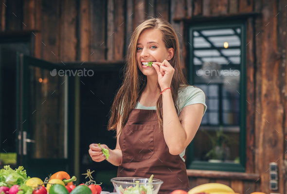 Attractive chef cooking in the kitchen - Stock Photo - Images