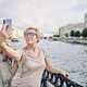 Senior female taking selfie on embankment - PhotoDune Item for Sale