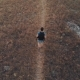 Man with Backpack Hiking Aerial View - VideoHive Item for Sale